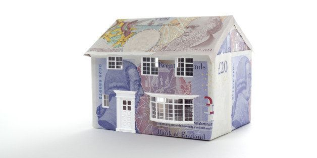 house made of british notes on white background