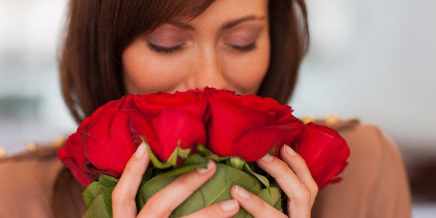 Woman smelling roses