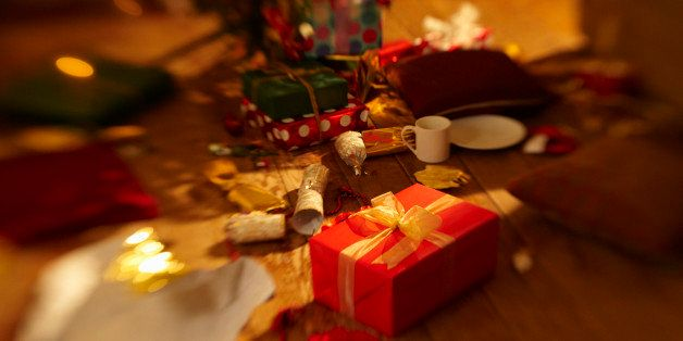 Christmas presents surrounded by mess