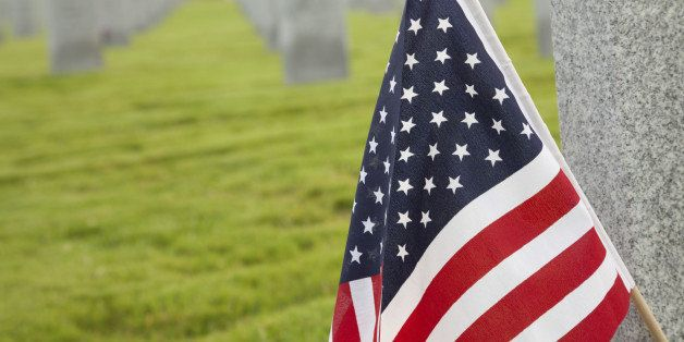 American Flag on Tombstone at a Cemetery.See more cemetery images: