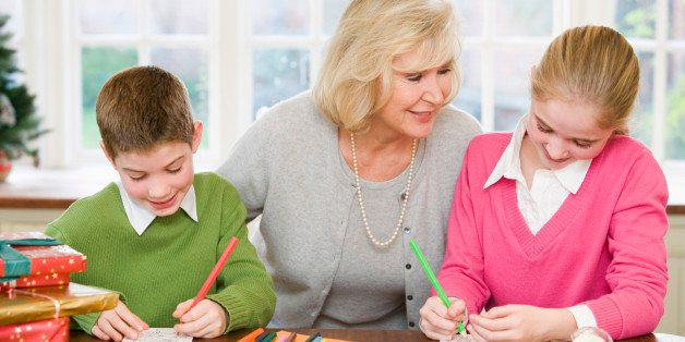 Grandmother and grandchildren making Christmas cards
