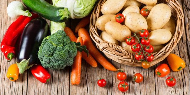 Fresh vegetable on old wooden table, top view