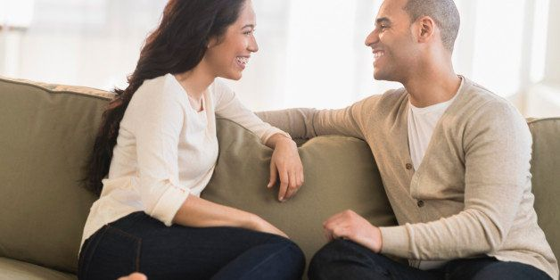 USA, New Jersey, Jersey City, Portrait of young couple sitting on couch