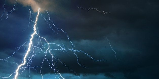 Fork lightning striking down during summer storm.