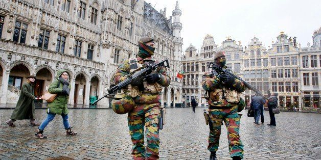 Belgium police officers patrol the Grand Place in central Brussels, Belgium, Tuesday, Nov. 24, 2015. The lockdown has closed the capitalᅢ까タᅡルs subways and schools. Officials have recommended that popular shopping districts be shuttered and advised people to avoid public places since they could be targeted by terrorists. (AP Photo/Michael Probst)