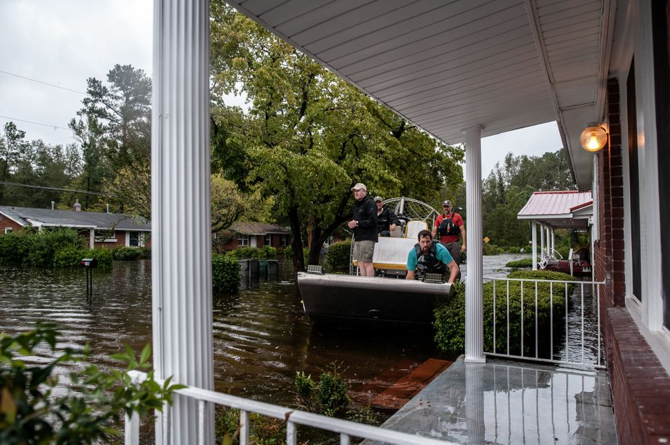 A boat crew with the Cajun Navy goes house to house to check for people in need of evacuation in Lumberton.