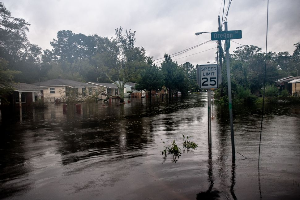 A neighborhood on the south side of Lumberton is inundated with rising floodwaters from the Lumber River on Sunday.