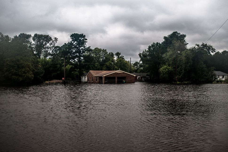 Lumberton saw rising floodwaters throughout Sunday as the Lumber River rose over its banks and inundated the south side of to