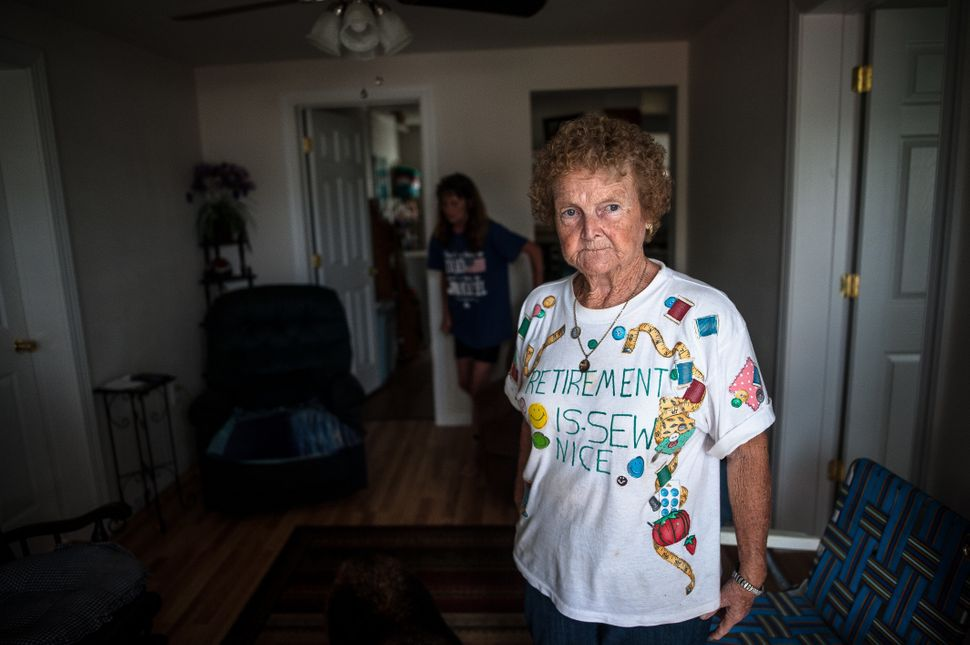 Linda Prevatte and Mary Jane Allen stand in their home in Lumberton, watching floodwaters rise and deciding whether to evacua