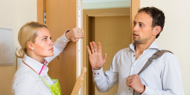 Conflict between wife and husband at the door