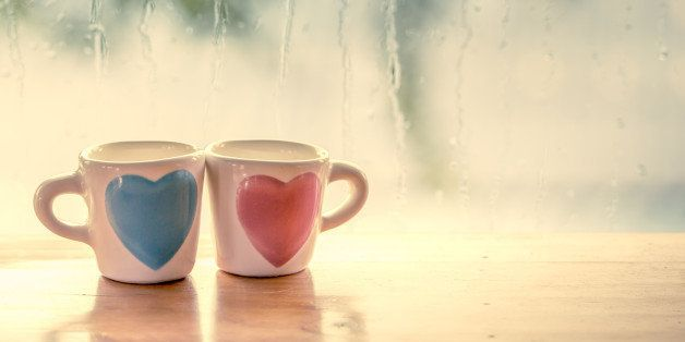 two lovely glass on rainy day window background  in vintage color tone
