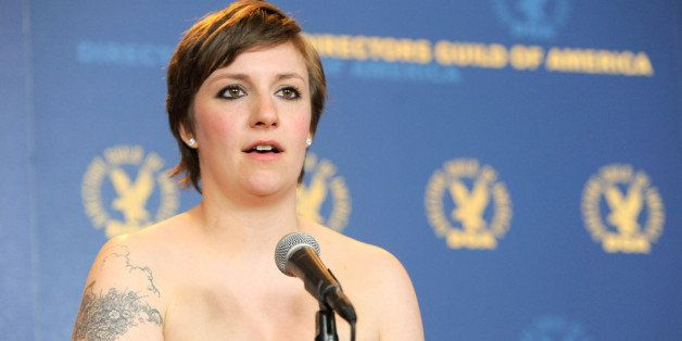 "Lena Dunham poses backstage with the comedy series award for ""Girls""' ""Pilot"" episode at the 65th Annual Directors Guild of America Awards at the Ray Dolby Ballroom on Saturday, Feb. 2, 2013, in Los Angeles. (Photo by Chris Pizzello/Invision/AP)"