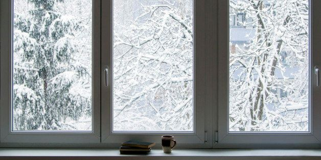 Books on the window in winter, snow in the background