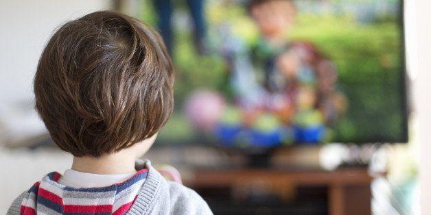 Small kid watching television