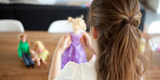 girl of 8 years old playing with dolls