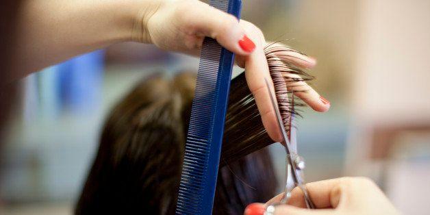 Woman 40s getting hair cut at hairdresser