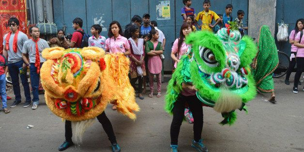 KOLKATA, WEST BENGAL, INDIA - 2016/08/02: Members of Kolkata's Chinese community celebrates New Year in Chinatown. The festivities includes drumming performances, lion dancers, dragon dancers and firecrackers. (Photo by Tanmoy Bhaduri/Pacific Press/LightRocket via Getty Images)