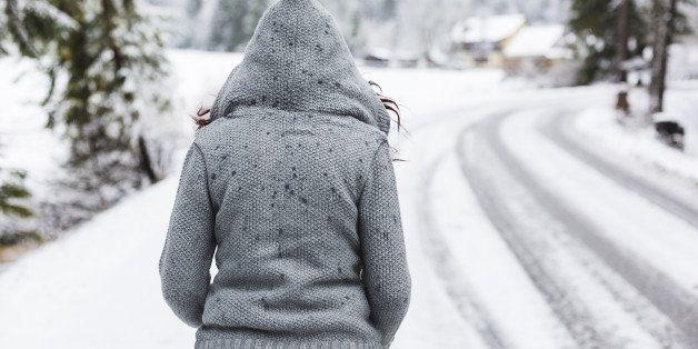 Woman enjoying a winter day on mountains.