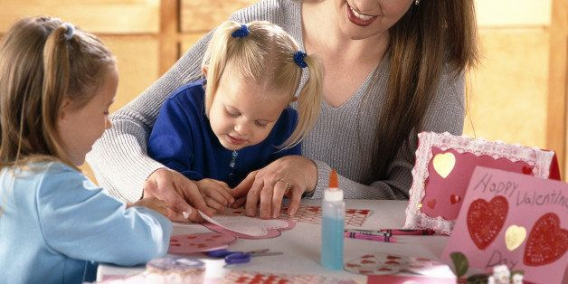 Woman and children coloring