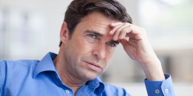 Mature man looking anxious, close up