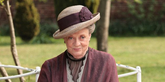 "In this image released by PBS, Maggie Smith as the Dowager Countess Grantham, is shown in a scene from the second season on ""Downton Abbey.""  The program was nominated for an Emmy Award for outstanding drama series on, Thursday July 18, 2013. The Academy of Television Arts & Sciences' Emmy ceremony will be hosted by Neil Patrick Harris. It will air Sept. 22 on CBS. (AP Photo/PBS, Carnival Film & Television Limited 2011 for MASTERPIECE, Nick Briggs)"