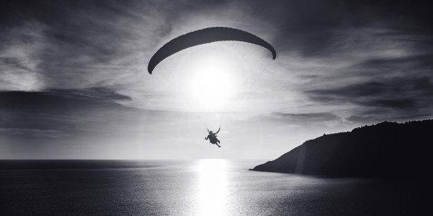 parachutist flying at sunset...
