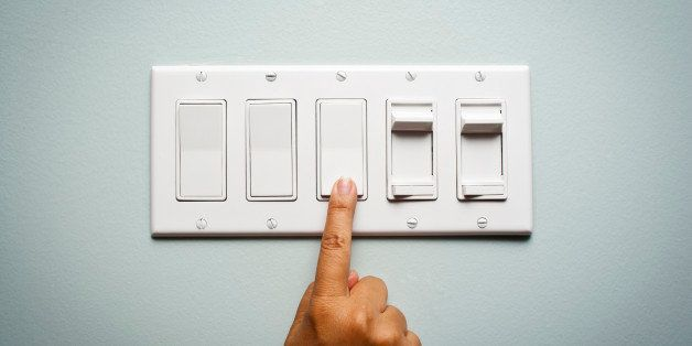 Woman's hand on a light switch