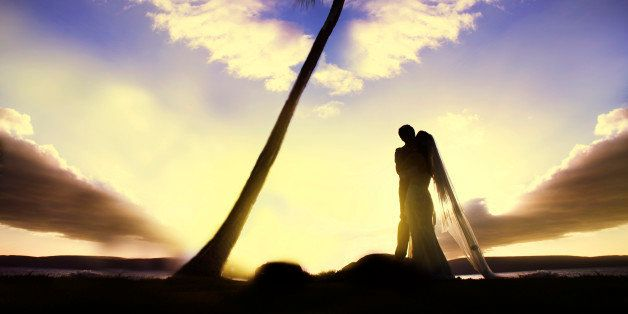This wedding photo is taken at Maui Hawaii during the sunset, featuring a romantic tone