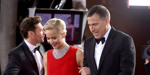 Jennifer Lawrence, left, and David O. Russell arrive at the 73rd annual Golden Globe Awards on Sunday, Jan. 10, 2016, at the Beverly Hilton Hotel in Beverly Hills, Calif. (Photo by Jordan Strauss/Invision/AP)