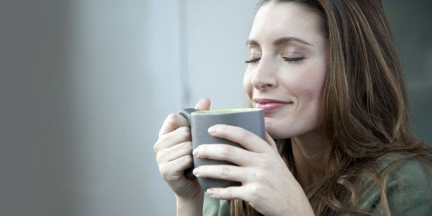 Caucasian woman drinking coffee