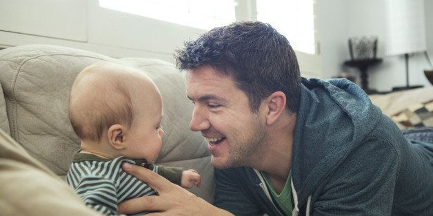 New Dad Playing with Baby