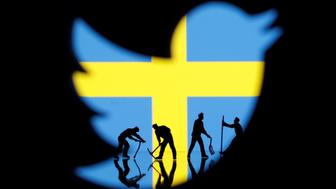 Small toy figures are seen through a 3D printed Twitter logo in front of a displayed Sweden flag in this illustration picture, September 5, 2018. Picture taken September 5, 2018. To match Exclusive SWEDEN-ELECTION/DISINFORMATION. REUTERS/Dado Ruvic/Illustration