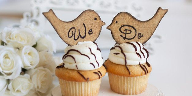 Wedding cupcakes with love bird toppers.