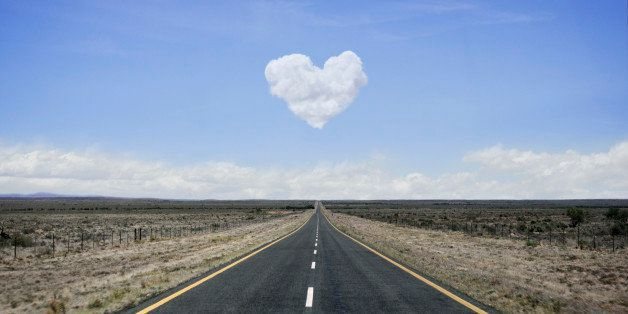 Remote road with heart shaped cloud over it.