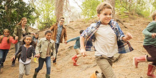 Children running in forest