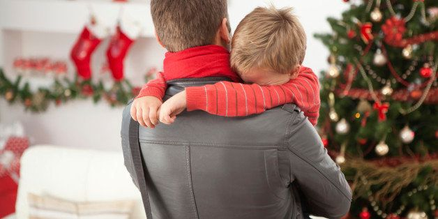 'Crying little boy hided his face into father's shoulder.Please, see CHRISTMAS images with this FAMILY, for lightbox click the image below.'