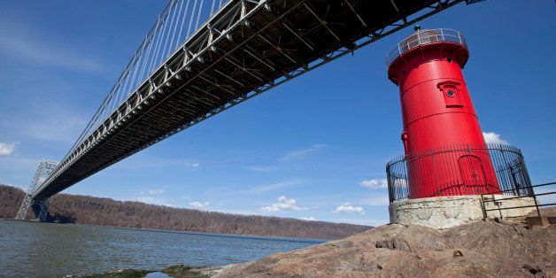 USA, New York, New York City, Jeffrey's Hook Light or Little Red Lighthouse below George Washington Bridge on Hudson River with blue sky above