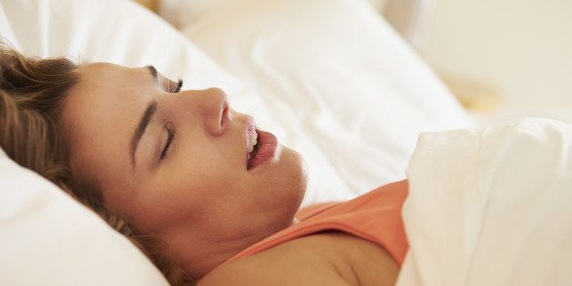 Close Up Of Overweight Woman Asleep In Bed Snoring On Her Own