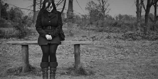 woman alone on park bench...