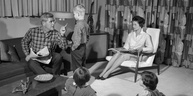 1960s FAMILY OF FOUR IN LIVING ROOM BOY IS BEING DISCIPLINED BY DAD SHAKING FINGER  (Photo by H. Armstrong Roberts/ClassicStock/Getty Images)