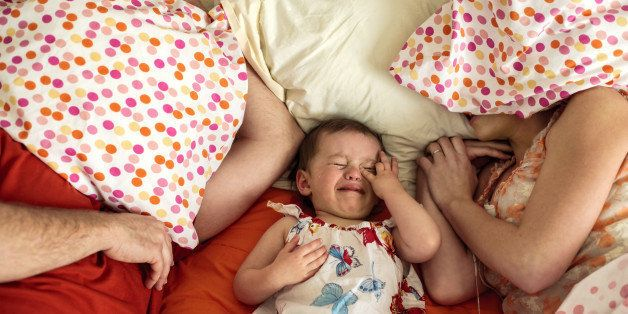 Crying toddler with parents