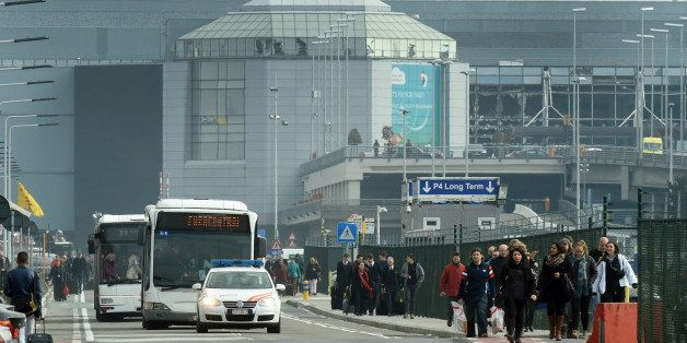 people are evacuated from Zaventem Airport in Brussels by bus after an explosion on Tuesday, March 22, 2016. Explosions, at least one likely caused by a suicide bomber, rocked the Brussels airport and subway system Tuesday, prompting a lockdown of the Belgian capital and heightened security across Europe. At least 26 people were reported dead. (AP Photo/Geert Vanden Wijngaert)
