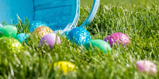 A stock photo of Decorated Easter eggs in an Easter. Photographed with low depth of field with a green grass background. Photographed using the Canon EOS 5DSR at 50mp and the 100mm f2.8 IS L macro lens. Perfect for designs or articles about easter or an easter egg hunt.