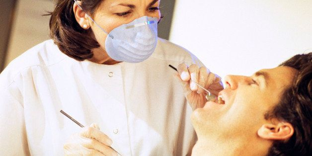 Dental hygienist and patient