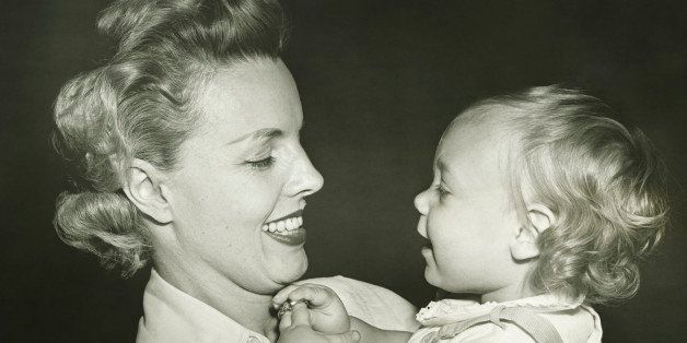 Woman holding daughter (12-18 months), (B&W), close-up