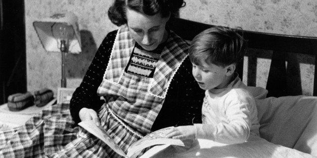 30th January 1954:  Scotland's youngest film star Vincent Winter is ready for bed and Mum tells him a story. Original Publication: Picture Post - 6884 - Vincent Winter: Scotland's Youngest Film Star - pub. 1954   (Photo by Carl Sutton/Picture Post/Getty Images)