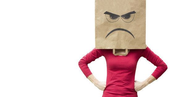 Woman with paper bag on her head with an angry expression on it