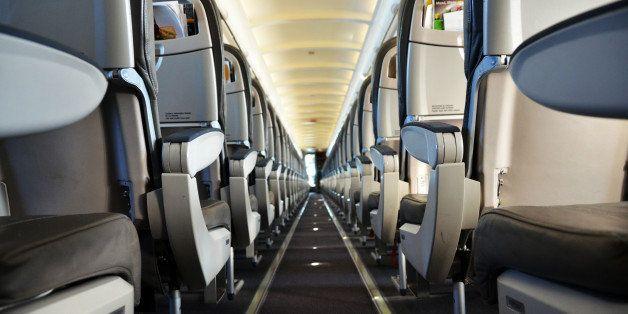 Single aisle airliner cabin interior.