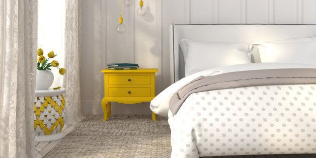 Modern bedroom in white color with yellow accents