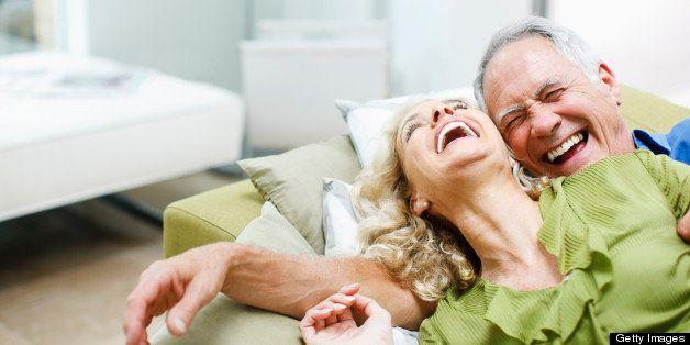 Couple laying on sofa together
